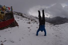Joe celebrating our ascent with a hand stand!