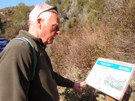 Checking out an in situ map to work out the route to the climb