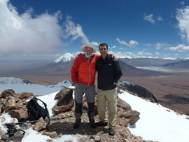 On the summit of Cero Toco with my good friend Aldo.  The moutnaisn of Bolivia and the beautiful Laguna Verde in the background.