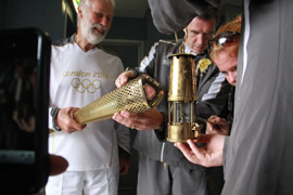 Lighting the torch from the miners lamp