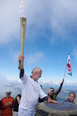Chris at the top with the Olympic flame