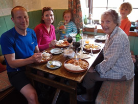 The family enjoying curry at the hostel