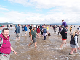 Splashing through the sea at Morecambe Bay