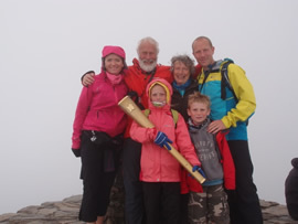 Chris and family with his Olympic torch on Snowden